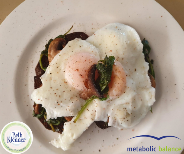 Metabolic Balance Eggs poached with sauteed mushrooms and spinach on rye